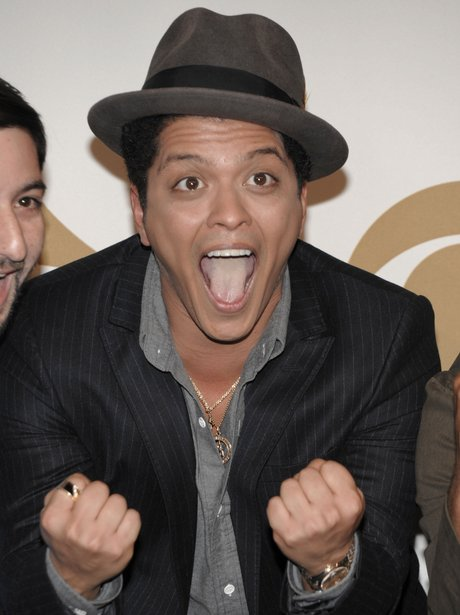 Bruno Mars is seen backstage at the Grammy Nominat