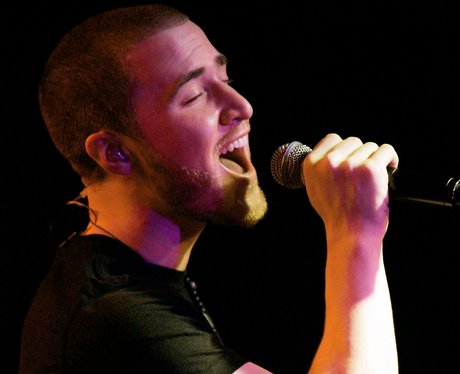 Mike Posner performs on stage