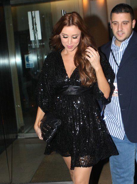 Una Healey shows off her enagement ring as she leaves The Saturdays' after tour party with her boyfriend