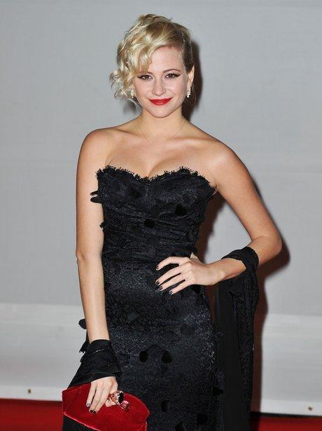 Pixie Lott arrives at the BRIT Awards 2012.