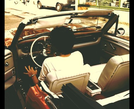 Harry Styles in a Mustang