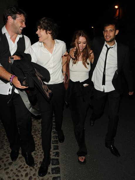 Harry Styles and Una Healy at a wedding.