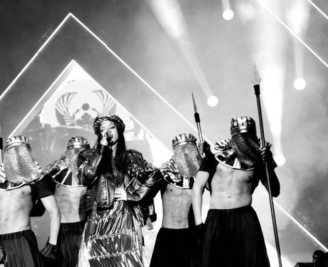 Rihanna and backing dancers perform live on stage