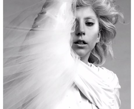 Lady Gaga wears wedding style dress in new shoot.