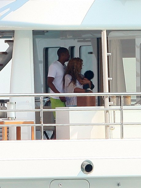 Jay Z and Beyonce with Blu Ivy on Holiday.