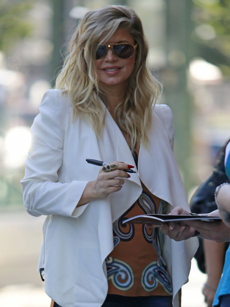 Fergie signs autographs for fans in NYC.
