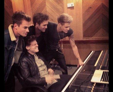 Lawson listening to their album in the studio