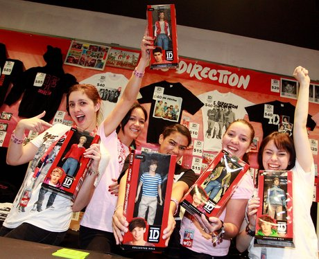 One Direction fans with merchandise.