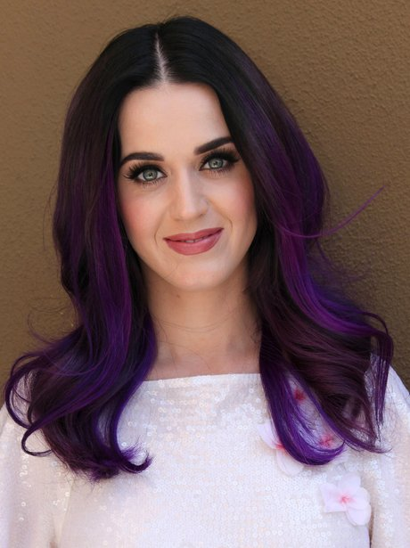Katy Perry poses with purple hair.