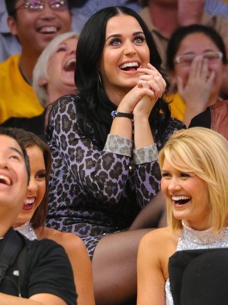 Katy Perry watches NBA game.
