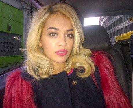 Rita Ora in a taxi.