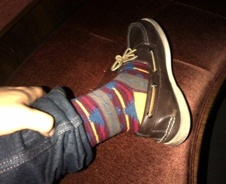 Bruno Mars wearing christmas socks