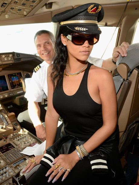 Rihanna in the cockpit of plane