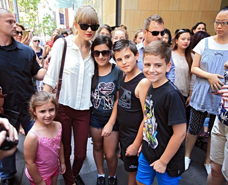 Taylor Swift posing with fans in Australia