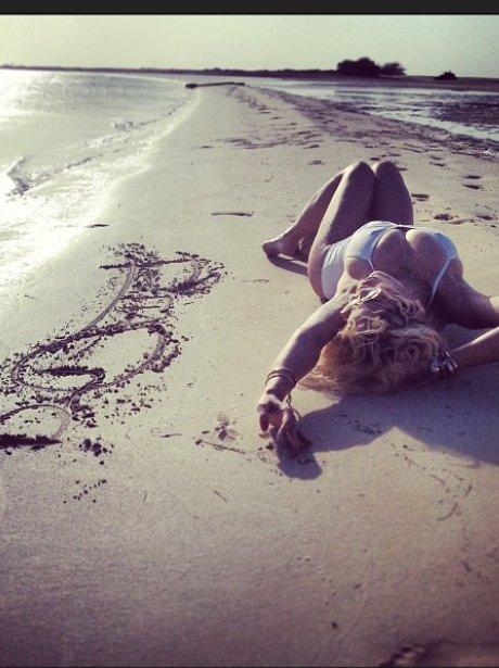 Rita ora on a beach