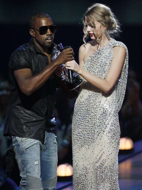 Kanye West takes the microphone from singer Taylor