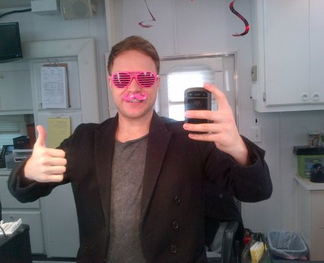 Olly murs wearing pink glasses
