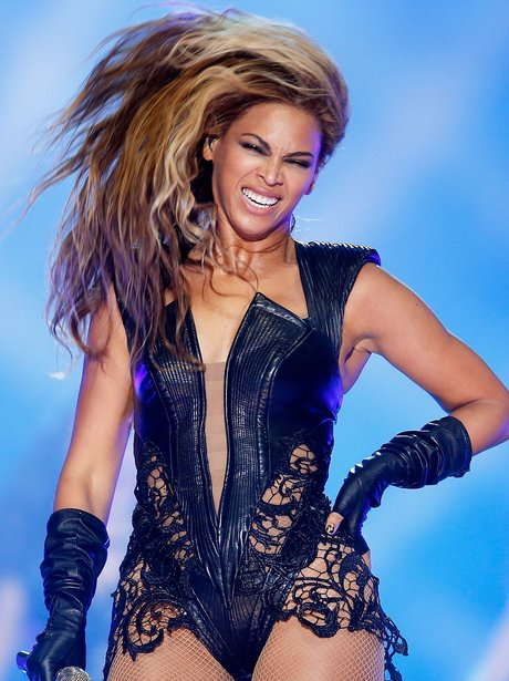 Beyonce flicks her hair in black lace outfit at the Super Bowl 2013