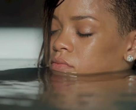 Rihanna sitting back in stay video bath tub