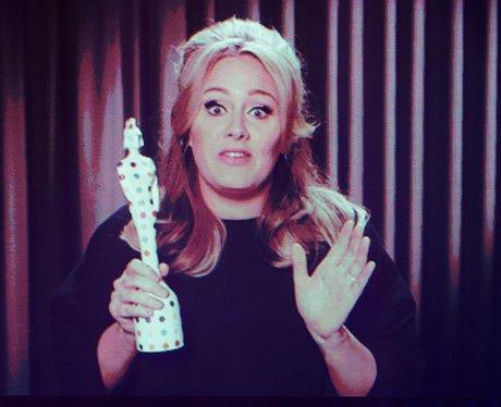 Adele accepts her Best British Singl