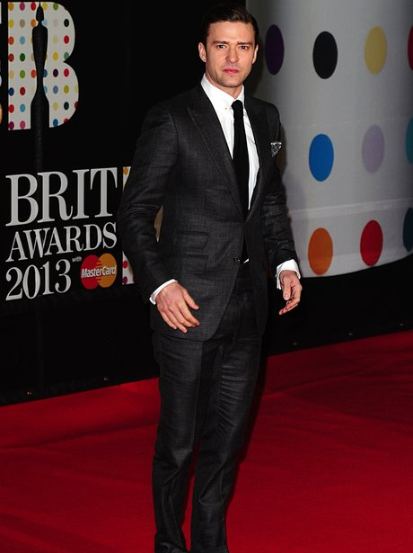 Justin Timberlake wearing a suit on the red carpet at the 2013 Brit Awards
