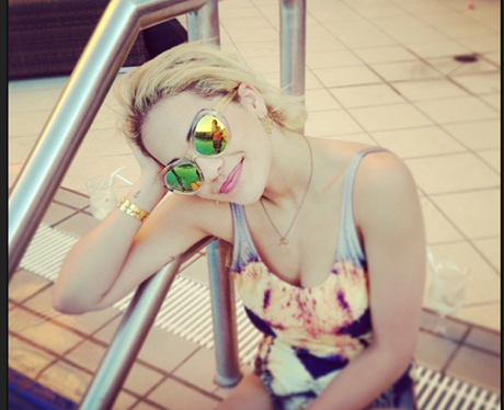 Rita Ora by the pool after performing in Australia