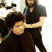 Image 10: Bruno Mars gets his hair cut in a barber shop