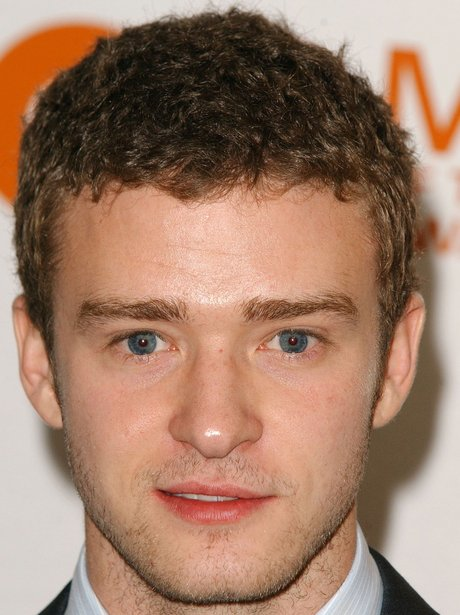 31 photos of justin timberlakes changing hair through the years justin timberlake with short curly hair in 2003 urmus Choice Image