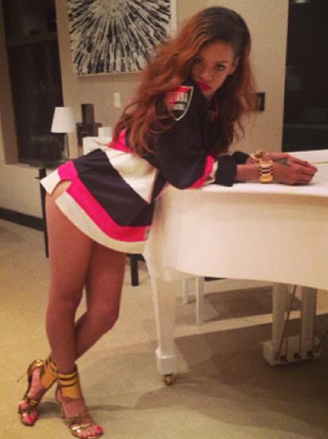 Rihanna leaning on a piano