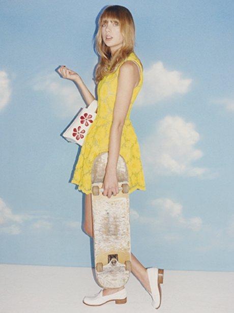 Taylor Swift holding a skateboard in Wonderland Magazine April 2013