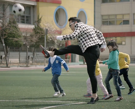 PSY playing football