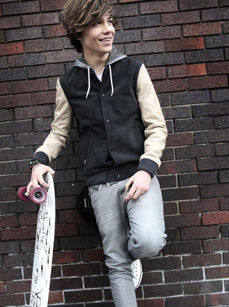 Union J's George holding a skateboard