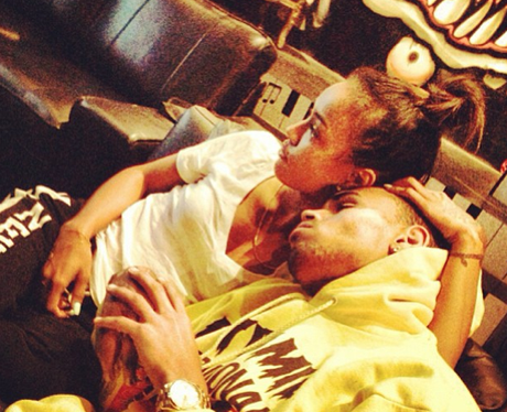Chris Brown and Karrueche cuddling on sofa