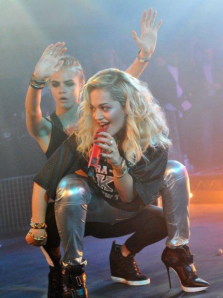 Rita Ora and Cara Delevingne  on stage