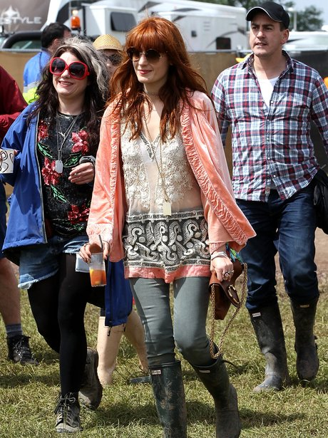 Florence Welch carrying a drink at Glastonbury