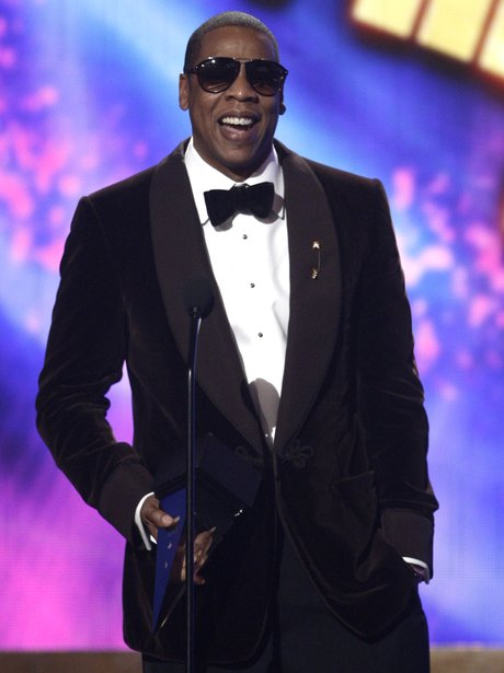 Jay z with his award at the American Music Awards