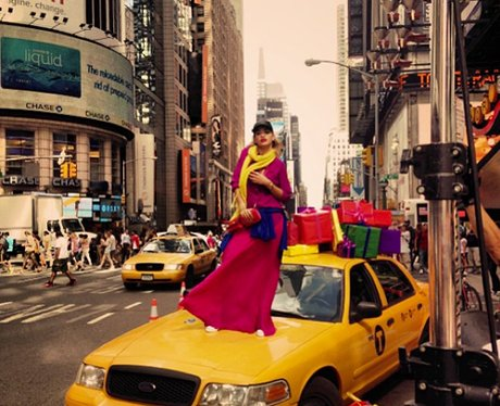 Rita Ora standing on the bonnet of a New York taxi