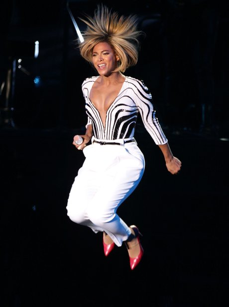 Beyonce jumping in the air at V Festival