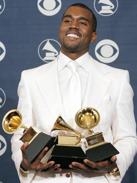 Kanye West holding Grammy Awards