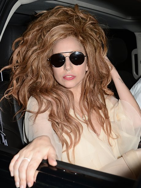 Lady Gaga leaving a restaurant with messy hair