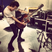 Image 10: Harry Styles playing the guitar