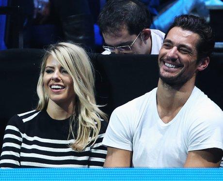 Mollie King and David Gandy watching tennis