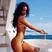 Image 10: Rihanna posing topless in a bikini