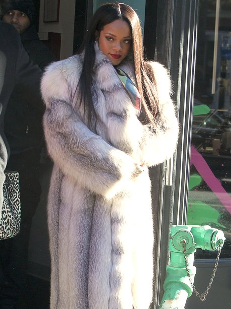 Rihanna wearing a fur coat