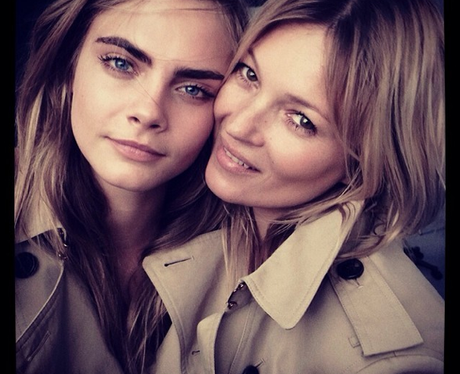 Cara Delevigne and Kate Moss in trench coats
