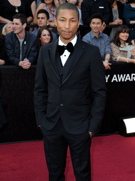 Pharrell wearing a suit