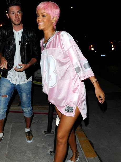Rihanna wearing a pink outfit