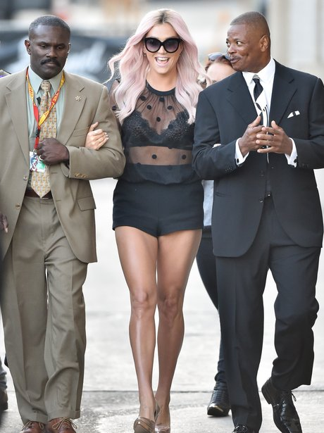 Kesha with body guards on the Jimmy Kimmel show
