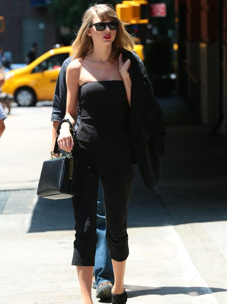 Taylor Swift wearing a black playsuit