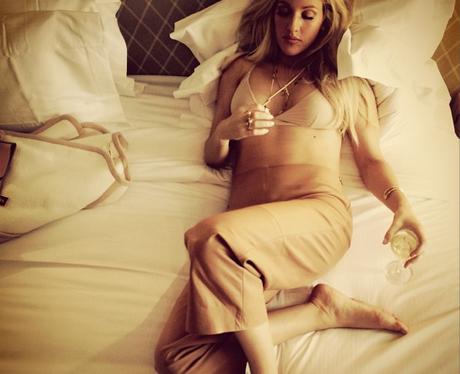 Elliw Goulding lying on her bed in underwear